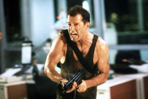 John-McClaneDie-Hard-1988Before-he-started-talking-to-chairs-Clint-Eastwood's-Dirty-Harry-was-the-epitome-of-the-trigger-happy-catchphrase-cop.-Yet-out-of-his-legacy-crawled-John-McClane-–-bloodied-bruised-and-probably-we-650x438