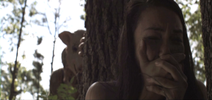 madison-county-movie-hiding-behind-a-tree-pig-mask